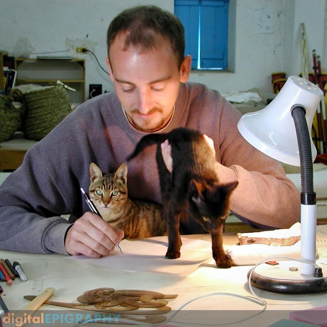 Drawing fragments from the Osiris Temple at Abydos with assisting cats