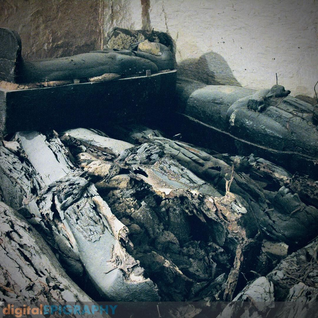 Severely damaged wooden coffins and jars, filled with ceramics, textiles and natron in KV 63